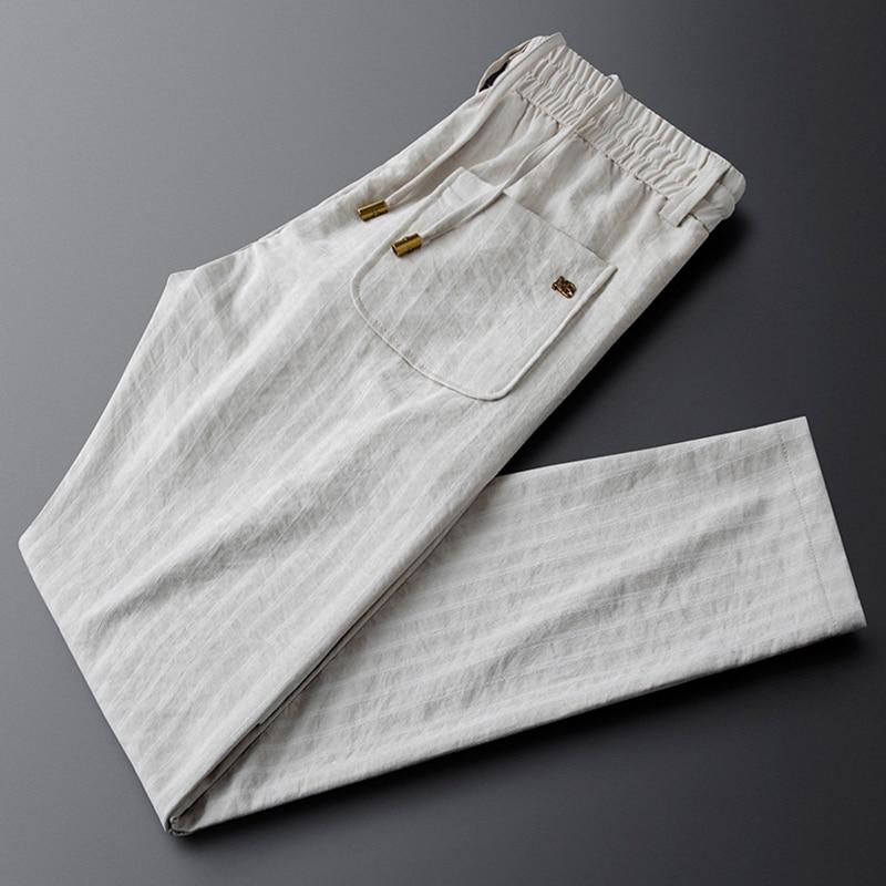 Beige elastic waist trousers feet straight casual pants men's slim summer thin striped guard pants