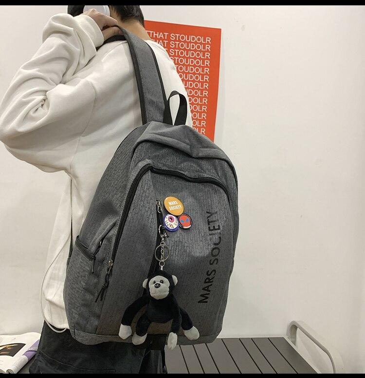 BB1763 النساء تتجه طلاب الجامعات الحرم الجامعي المدرسة الثانوية حقيبة ظهر كورية عادية بسيطة الرجال على ظهره