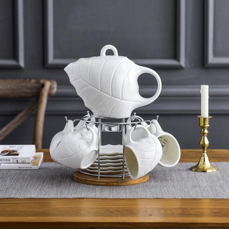 النمط الأوروبي خشبية قوس كوب معلقة شمعة التدفئة ورقة شكل السيراميك طقم شاي القهوة مطعم المنزل العظام الصين القهوة مجموعة