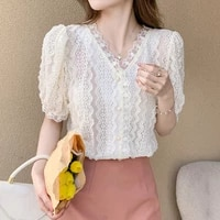 real shot spring and summer womens korean version of the wild stitching v neck short sleeved puff sleeve hollow lace shirt top