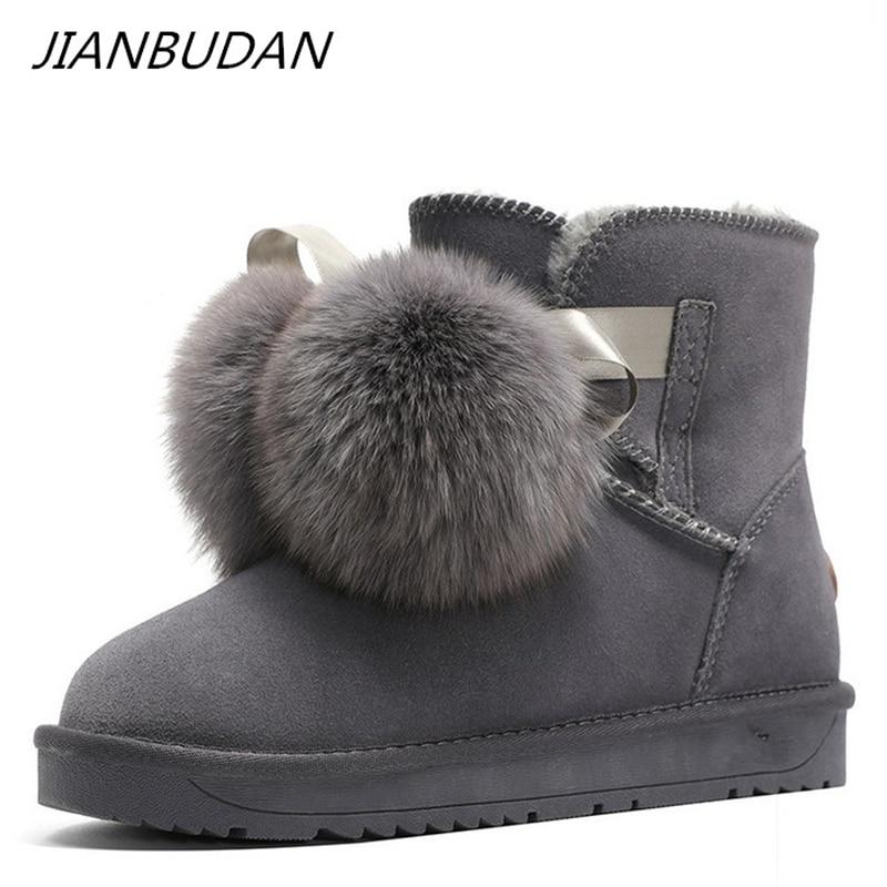 JIANBUDAN, botas de nieve de cuero genuino para mujer, botines cálidos de felpa de invierno, Bola de Pelo de zorro, botas de algodón plano a la moda encantadoras 35-40