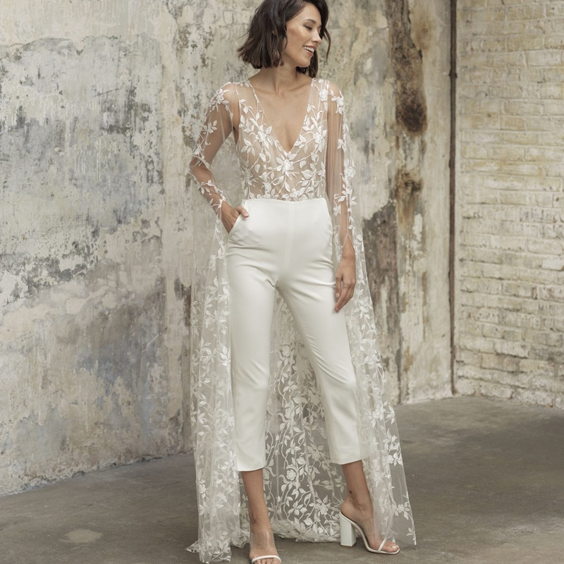 Promo Sexy Deep V-Neck Wedding Dress For 2021 Lace Appliques Cape Design Sleeveless Sweep Train Backless Elegant Bride Gown Pantsuit