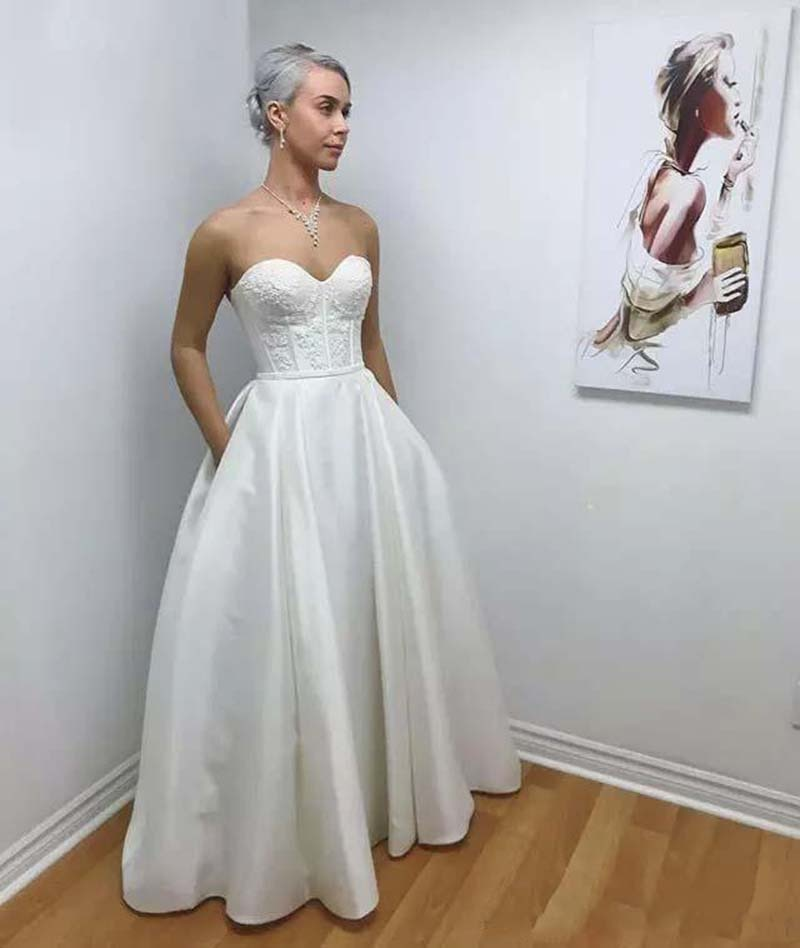 2020 elegant a line wedding dresses illusion v neck appliques sweep train bridal gowns with beaded sash custom made Elegant Satin A Line Wedding Dresses Sweetheart Appliques Bridal Gowns With Pocket Garden Simple Sweep Train Wedding Gowns