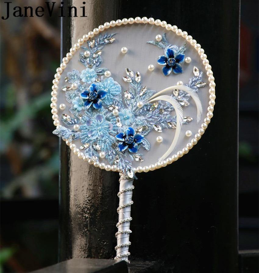 JaneVini-باقة زفاف من الريش باللون الأزرق الجليدي على الطراز الصيني ، إكسسوار مروحة الزفاف مع خرز كريستالي