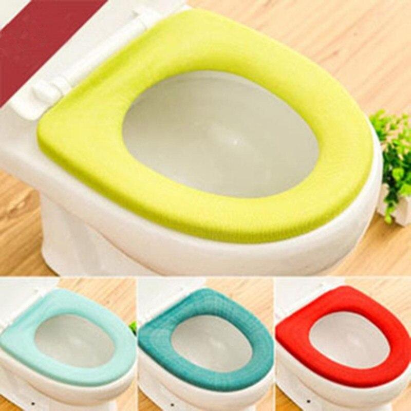 1pc de asiento de inodoro Color al azar calentador de baño accesorios cerca taburete suave lavable estera de cojín сиденье для унитаза 25