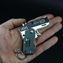 Tout métal mini peut être plié comme un porte-clés élastique pistolet cadeau pour enfants jouet six éclats de caoutchouc jouet pistolet jouet pistolet