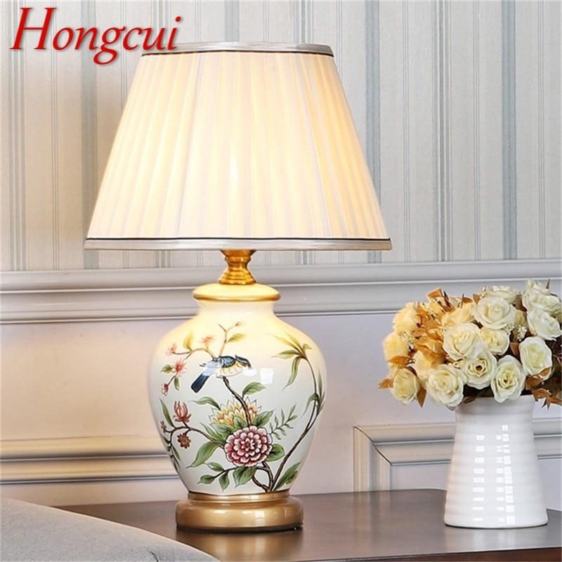 Hongcui مصابيح طاولة السيراميك النحاس الحديثة الفاخرة نمط مكتب ضوء LED Besjdes لغرفة نوم المنزل