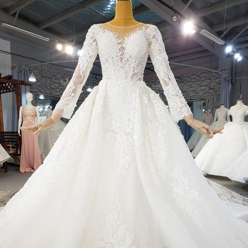 HTL2143 Elegant Applique Long Sleeve Transparent Lace Beaded Wedding Dress 2021 And Ground Trailing Bride Wedding Dress