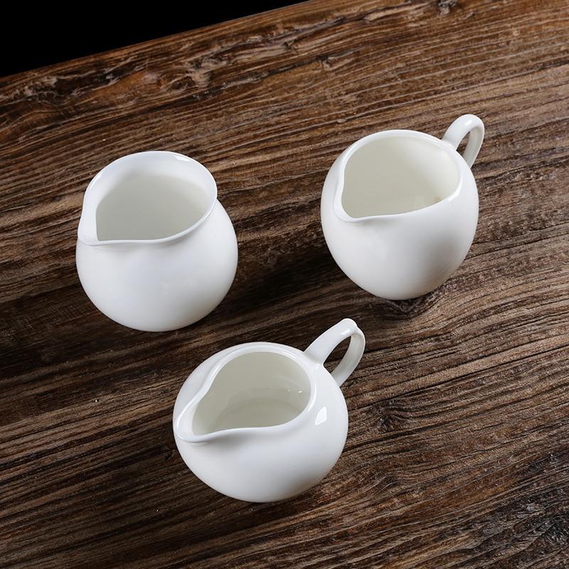السيراميك اليشم الخزف السيراميك الأبيض إبريق الشاي إبريق الإبداعية التقليدية براد شاي طقم شاي sitil براد شاي مصفاة