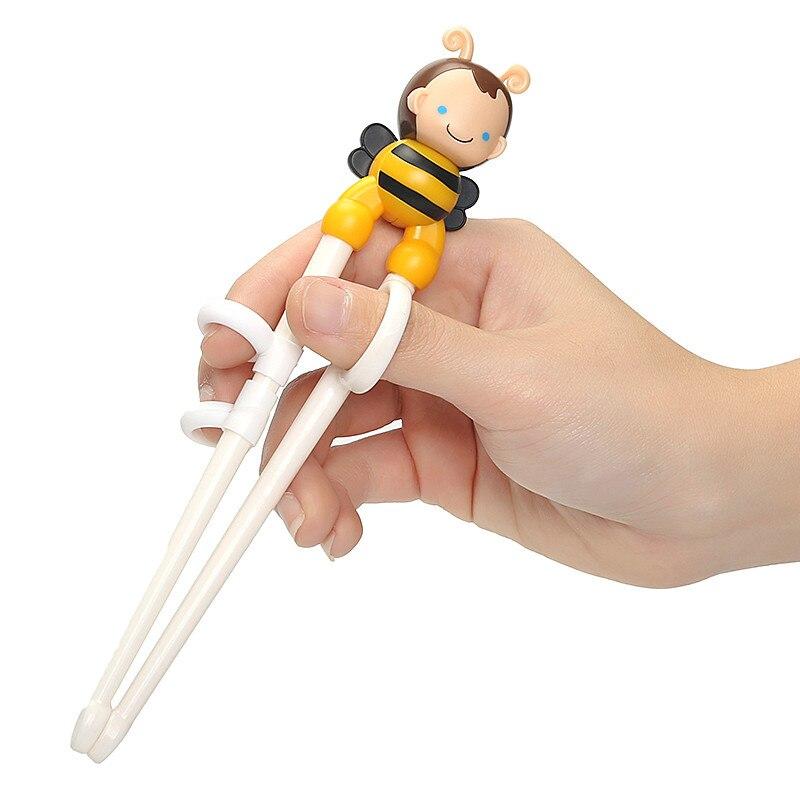 Gran oferta 1 par amarillo Color lindo abeja Minions aprendizaje entrenamiento palillos chico niños palillo chino aprendizaje regalos