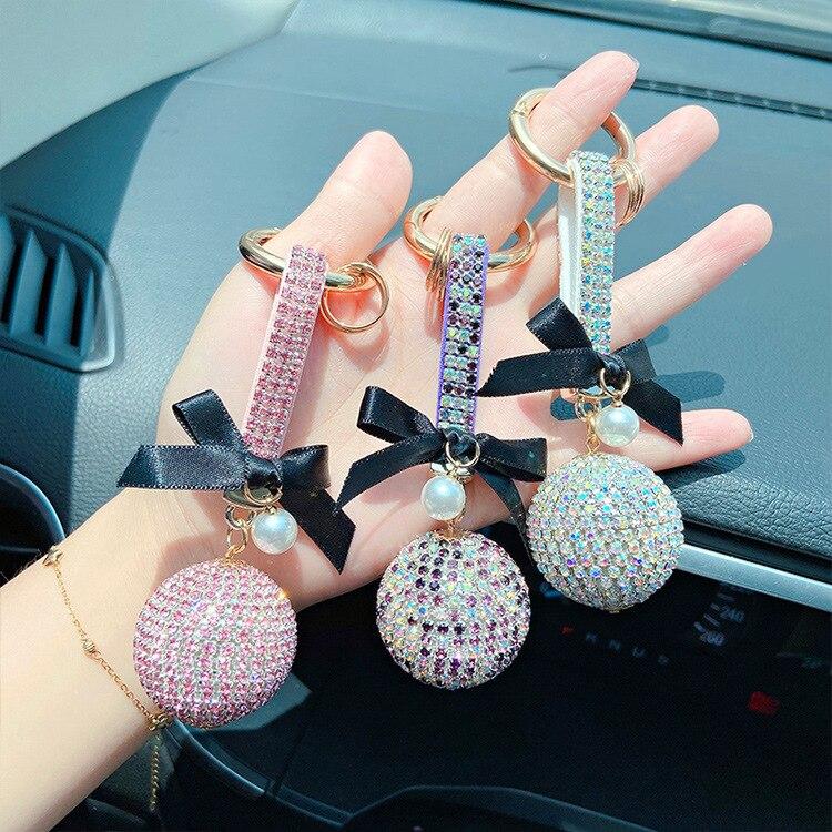 Popular creativo Diamante de imitación bola de cristal lindo womenllavero personalidad arco Bola de moda coche bolsa colgante de llavero regalo para las niñas