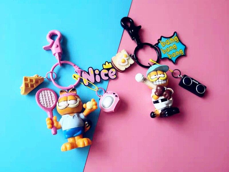 Llaveros Garfield, colgante con bolsa de tenis y béisbol, regalos creativos de pareja de dibujos animados, llaveros de muñecos de dibujos animados estilo Ins