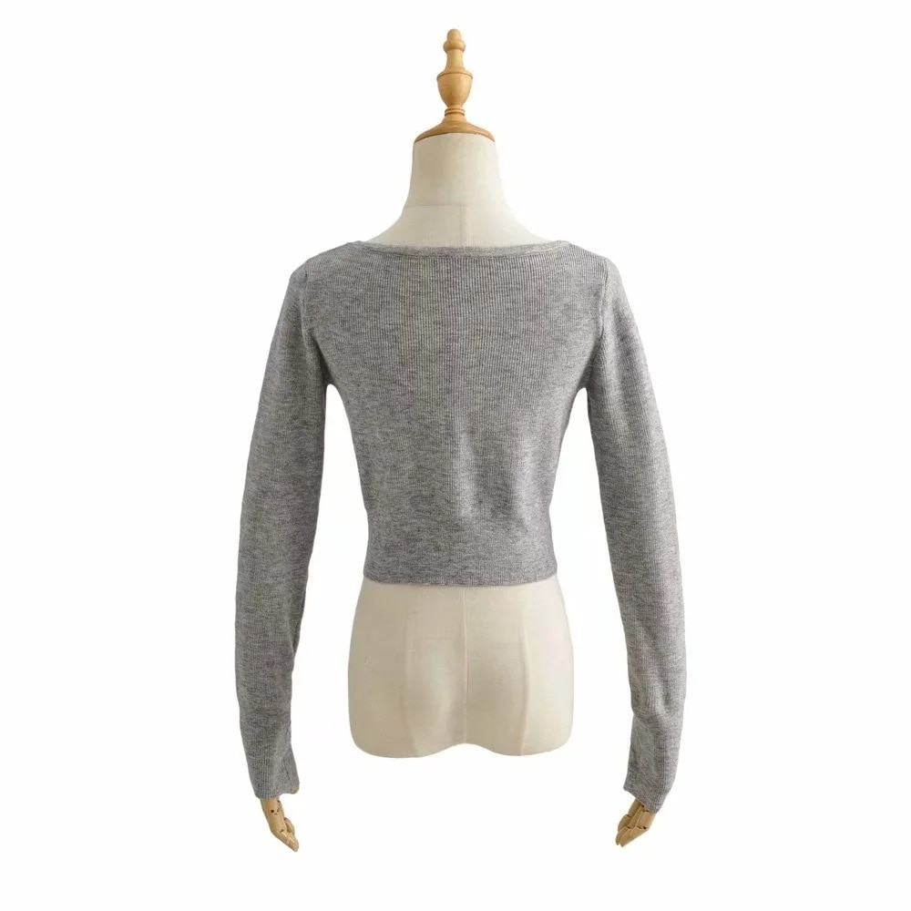 knitted cardigan ins European and American fashion button hollowed out sexy high waist short loose sweater coat enlarge