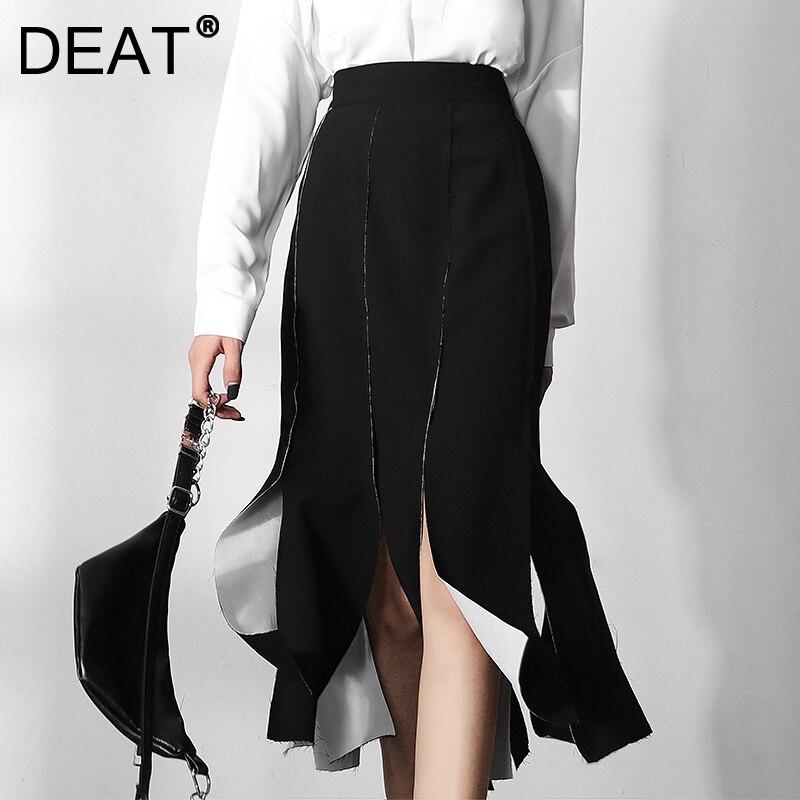 DEAT 2021 موضة جديدة أوائل الخريف تصميم جديد أبيض وأسود اللون التباين غير النظامية a خط حقيبة الورك متوسطة طول تنورة