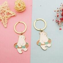 2 pièces Kawaii natation ours polaire porte-clés porte-clés couleur dorée alliage ours émail breloques flottant Fit bijoux à bricoler soi-même accessoire FX365