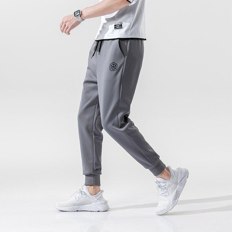 Pantalones de hombre de marca de alta calidad, pantalones elásticos casuales para Fitness, ropa de culturismo, pantalones de chándal casuales, pantalones de Joggers