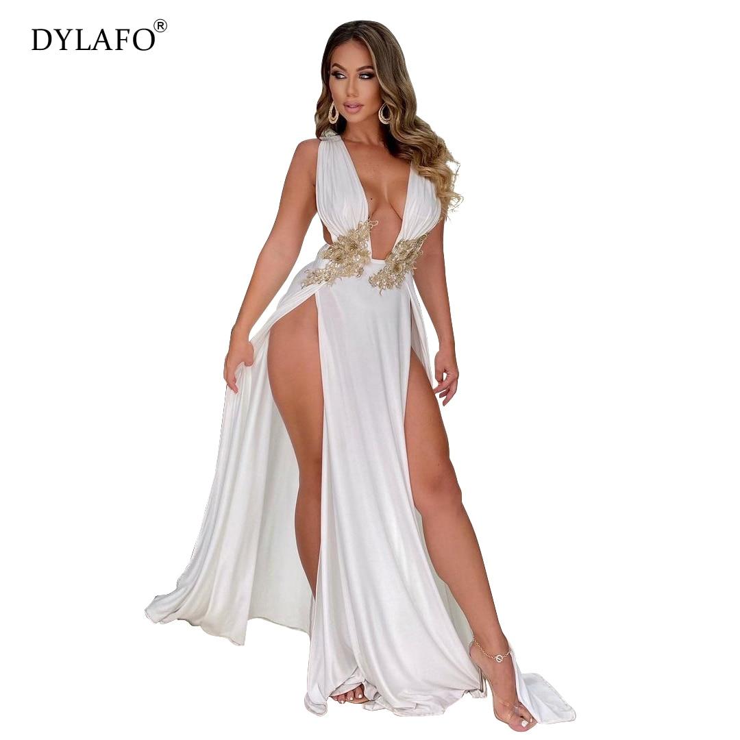 فستان أبيض لامع مزين بالترتر طويل للحفلات للنساء عميق رقبة على شكل V بدون أكمام طول الأرض فستان مثير ذو فتحة جانبية عالية