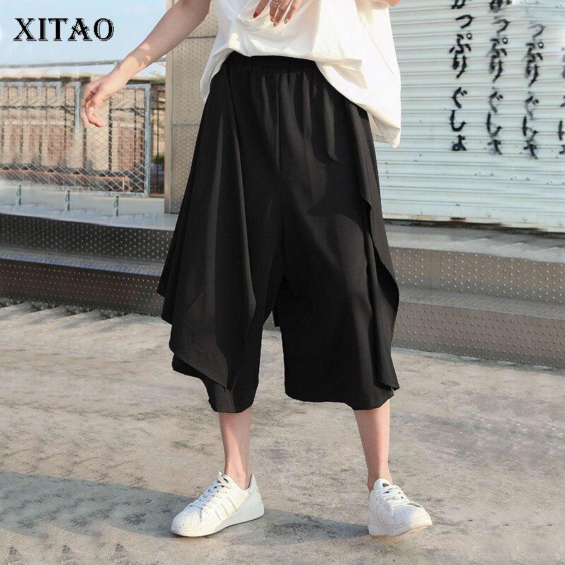 XITAO pantalones negros irregulares de moda nueva mujer cintura elástica 2020 verano pequeños frescos almazuela elegante pantalones DMY5011