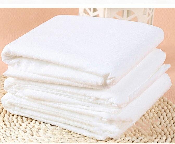 Bolsa de viaje desechable personalizada colcha o sábana cubierta sábana fundas de almohada SSS tejido saludable y evitar la infección blanca