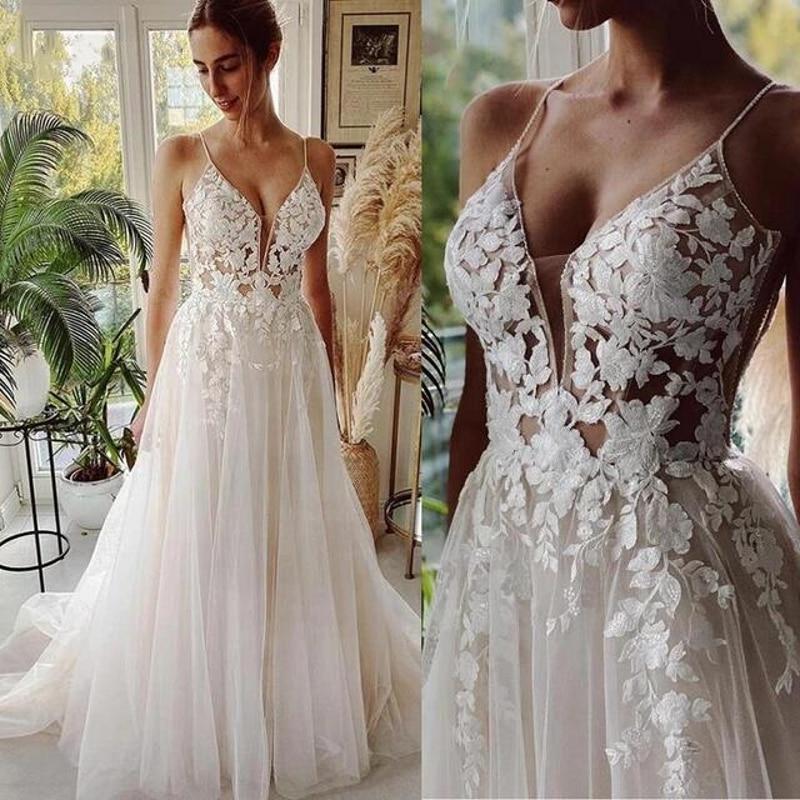 فساتين زفاف الشاطئ 2021 طويل تول دانتيل خمر فستان زفاف a خط ذيل محكمة بلوق v الرقبة Vestido de Noiva