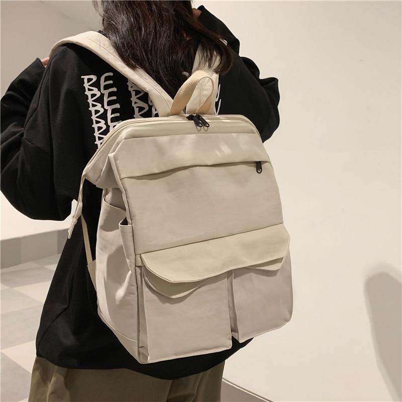 Schoolbag female Hong Kong nylon canvas backpack female large-capacity leisure Korean high school students solid color backpack недорого