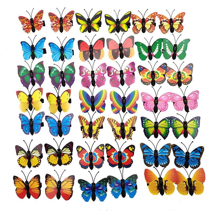 Venta al por mayor 100 unids/set colorido mariposa diseño perro lazos de aleación Clips accesorios para el cuidado de mascotas perro horquilla de gato perro proveedor