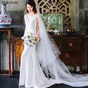 KAUNISSINA Wedding Dress Romantic Sleeveless Bride Gown Floor-Length White Satin Bride Dresses Deep V-Neck Sexy Vestido de Noiva