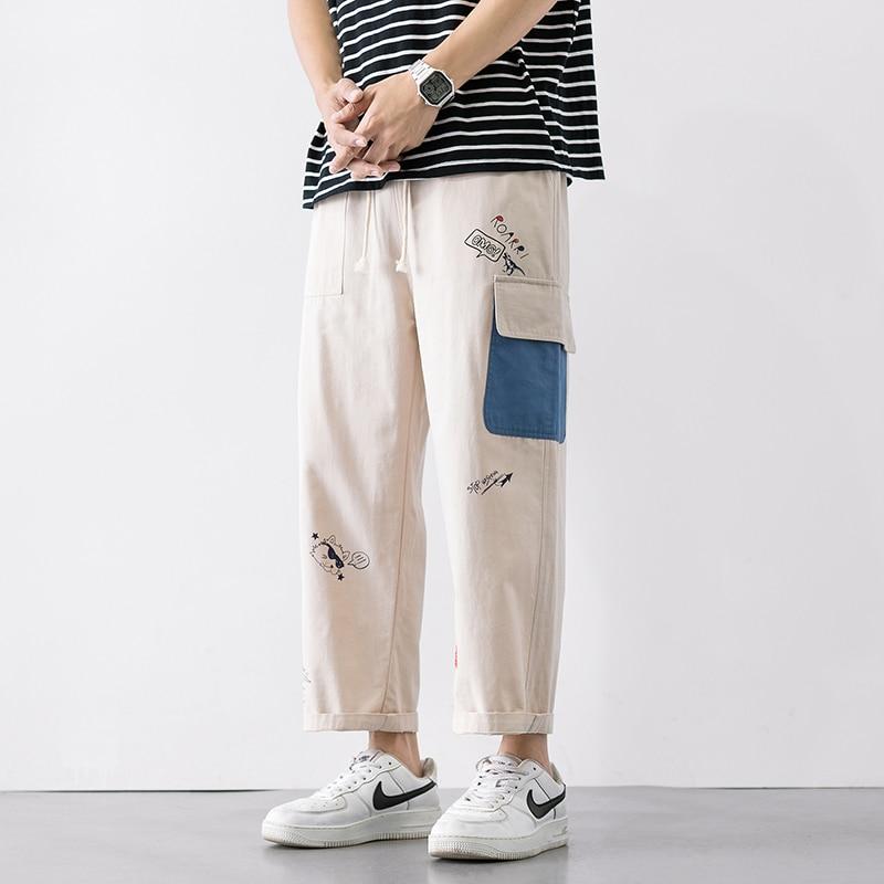 Męskie spodnie na co dzień proste 2020 japońskie spodnie Cargo męskie spodnie luźne kolaż szerokie nogawki męskie spodnie Streetwear