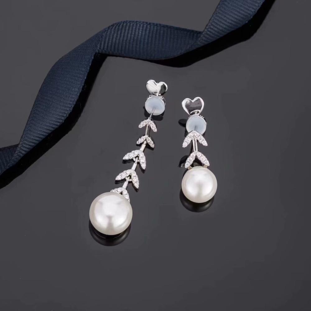 Nuevos pendientes de estambre de Súper Hada, joyería femenina, Pendientes colgantes de perlas de hoja, pendientes largos asimétrico, regalo