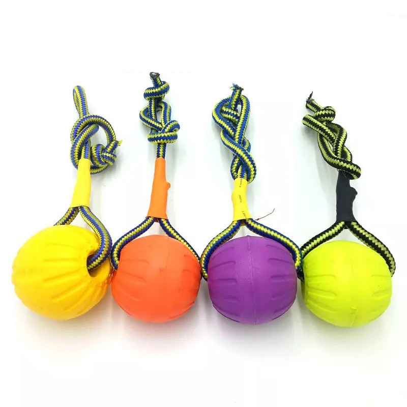 AliExpress - dog toys rubber training ball bite funny puppy chew toys play solid with rope dog petsuppliesCandy Colorshigh quality