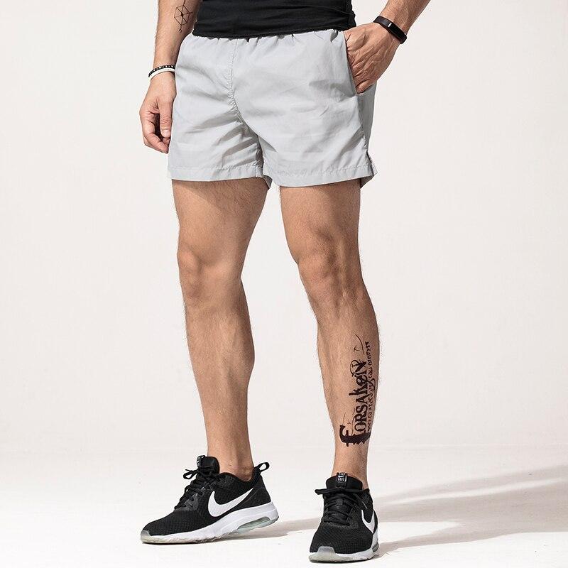 شورت رياضي رجالي يسمح بمرور الهواء ، سريع ، رياضي ، جري ، صيفي ، فضفاض ، ركض ، بدلة رياضية Spodenki Gasp ، كمال الأجسام ، XX60MS