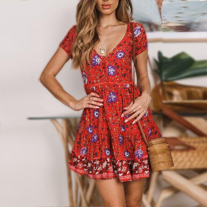 Modelos de explosión verano nuevas mujeres europeas y americanas sexy profundo floral vacaciones playa vestido verano mujeres vestido elegante