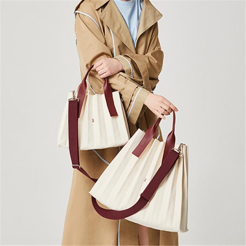 Design Hand Folded Handbag Women Solid Color Pleated Shoulder Bucket Commuter Package Designer Fashion Handbags Canvas bag