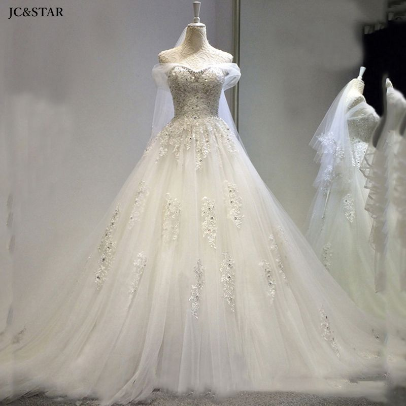 Vestido de novia, vestido de novia de marfil con hombros descubiertos y...