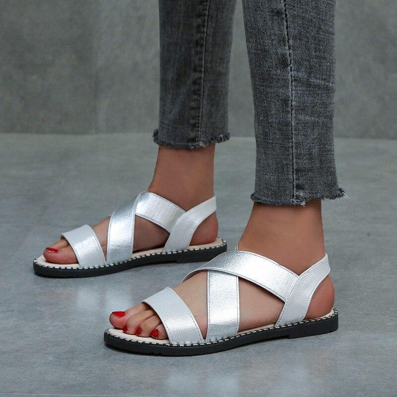 Mulher de Couro de Ouro Dedo do pé Sapatos Femininos Clássico Elástico Senhoras Sandálias Planas Costura Roma Aberto Feminino Verão 2021