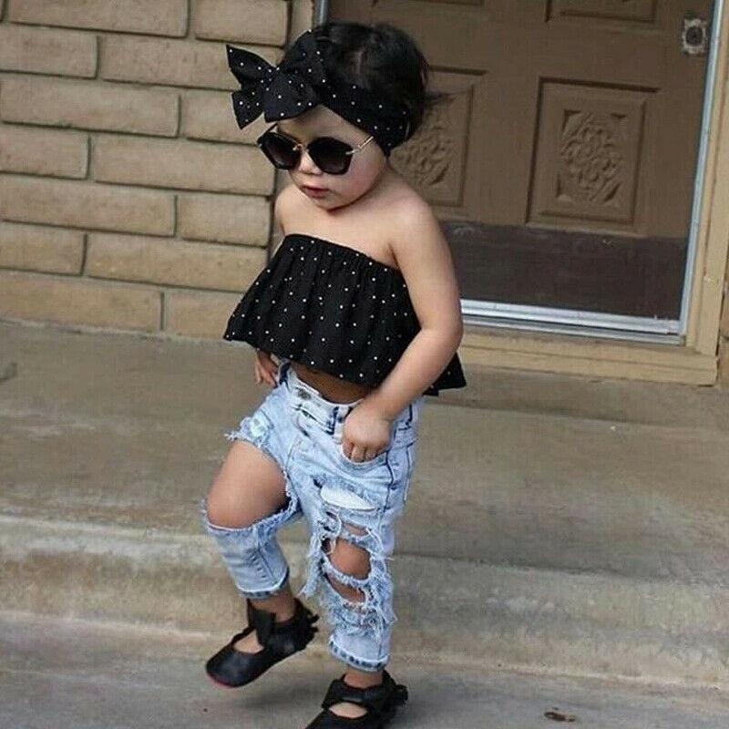 Conjunto de ropa de moda para bebés, Tops de tubo sin tirantes con hombros descubiertos para niñas, blusa negra, pantalones con agujeros de tela vaquera, conjunto de ropa para niños