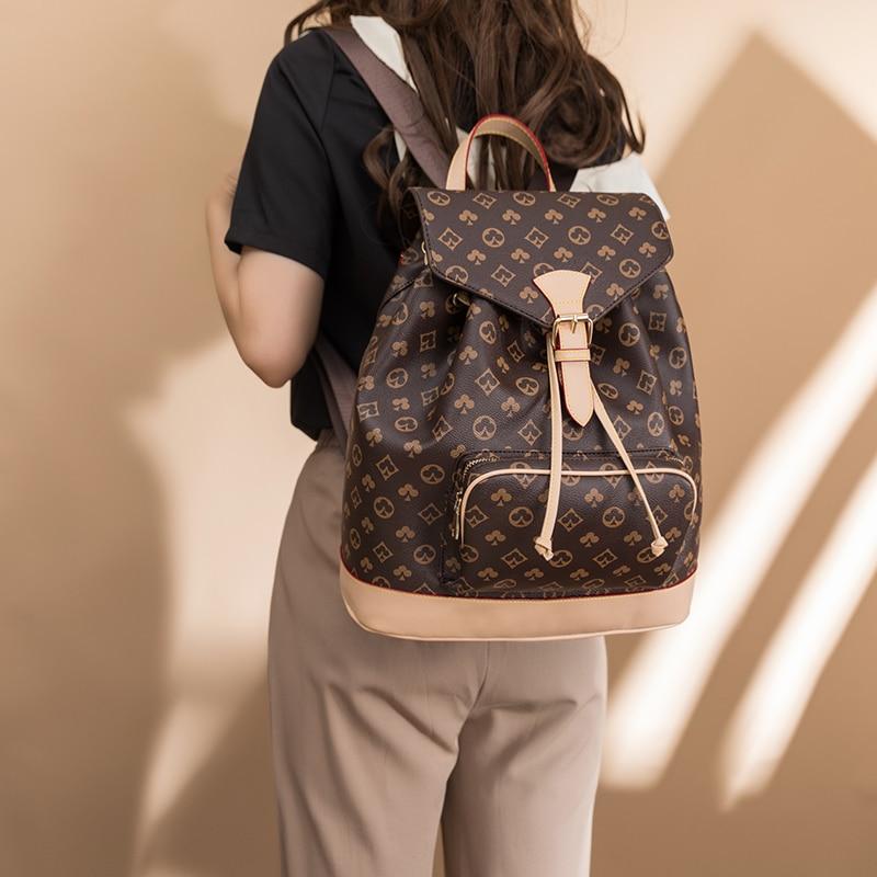 مطبوعة الراقية مصمم المرأة على ظهره 2021 صيف جديد جلد موضة كل مباراة سيدة السفر قطري حقيبة كتف