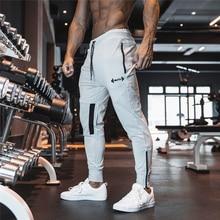 YEMEKE 2019 أحدث رجل Sweatpants رجل الجمنازيوم اللياقة البدنية كمال الاجسام ركض تجريب السراويل الرجال عارضة القطن سروال شكل قلم رصاص
