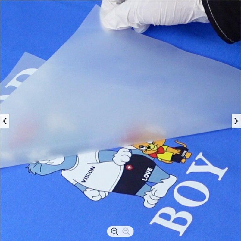 شحن مجاني 100 قطعة A4 DTF فيلم نقل للطباعة قميص مع التعبئة الآمنة
