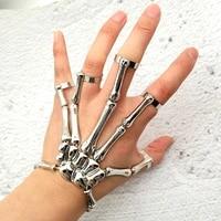 fashion personality punk skull hand bone wild five finger ring bracelet zinc alloy gun black elastic line adjustable