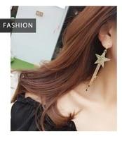 the new web celebrity earrings with the same style of temperament pentagram long tassel earrings korean nail trend