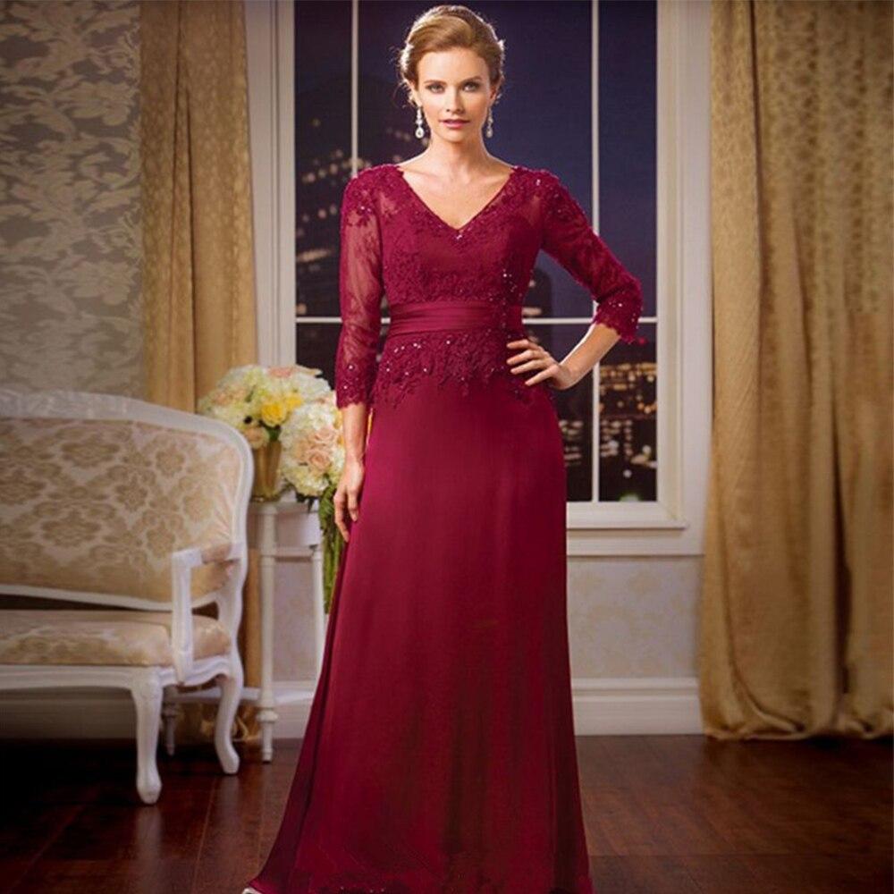 Женское платье с V-образным вырезом, длинным рукавом и поясом фото