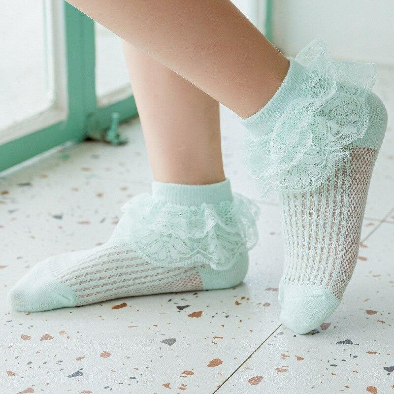 Nuevas medias de malla para bebés y niños, calcetín de algodón y encaje corto con volantes para verano, calcetines de niñas bebé transpirables con flores