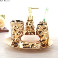 Ensemble de salle de bain en ceramique quatre pieces  porte-brosse a dents en or  distributeur de savon  boite a savon  accessoires de decoration de salle de bains  cadeaux de mariage