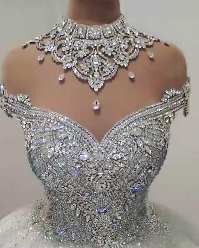 فستان زفاف دبي بكريستال لامع 2021 رقبة عالية شفافة فاخرة زي العرائس بدون ظهر مطرز الأميرة رداء دي ماري مصنوع حسب الطلب