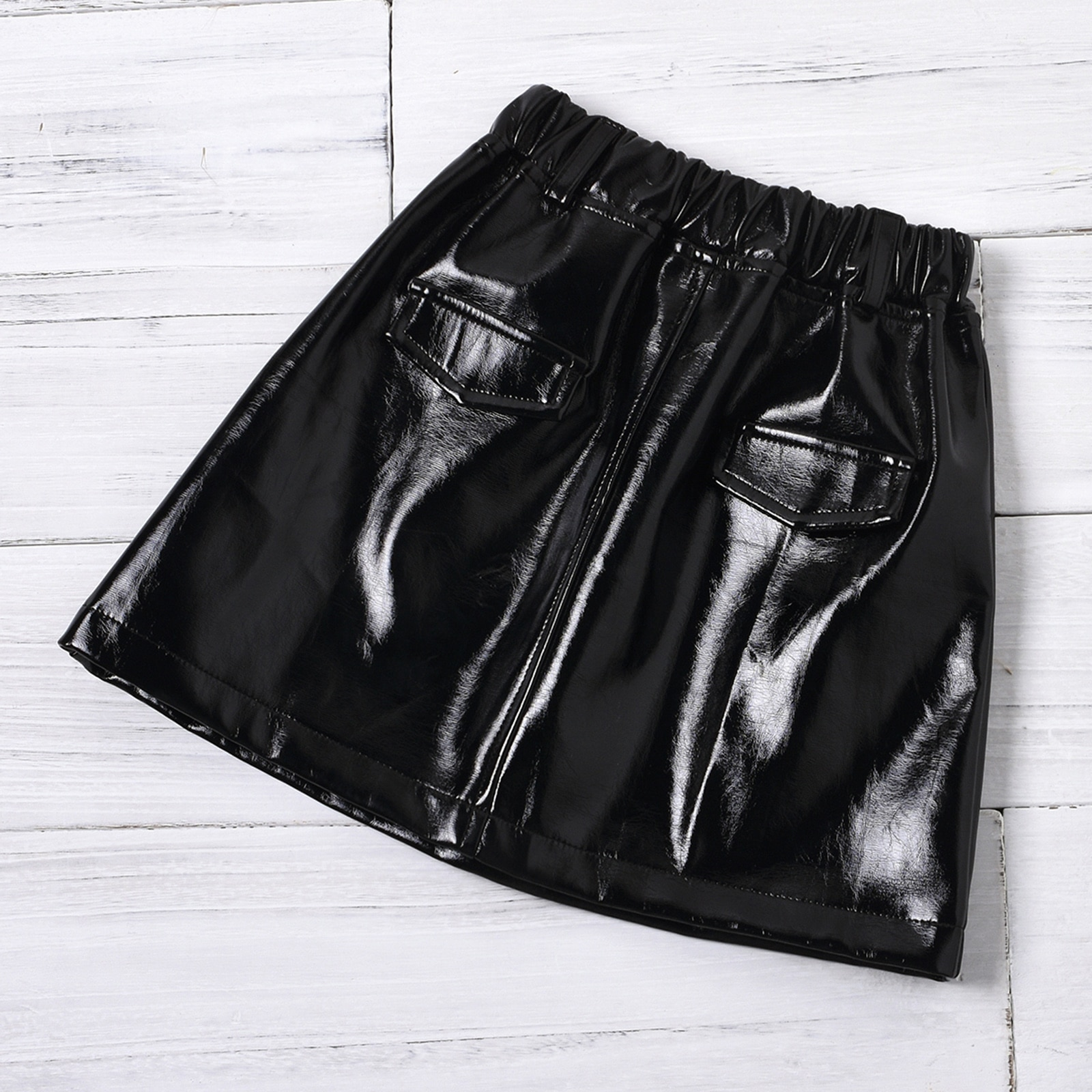 Купить с кэшбэком Girls Skirt Two Piece Suit Fashion Solid Color Boat Neck Lantern Sleeve Tops and Leather Short Skirt
