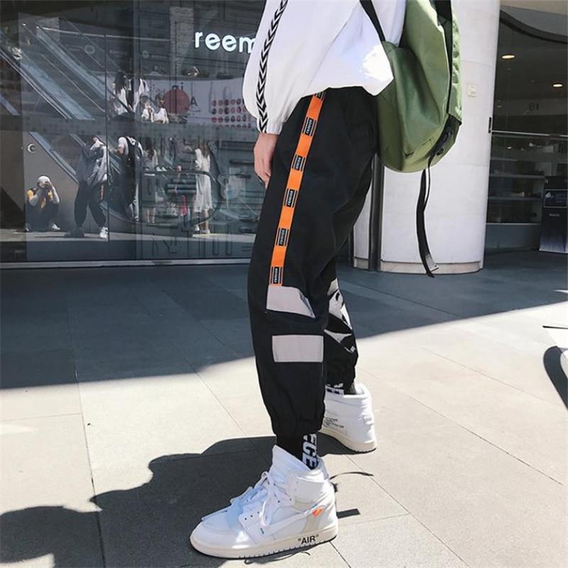2020 moda semana mismo párrafo baile lado pantalones de pista a rayas hombres corredores reflectantes etiqueta Harem pantalones holgados Streetwear