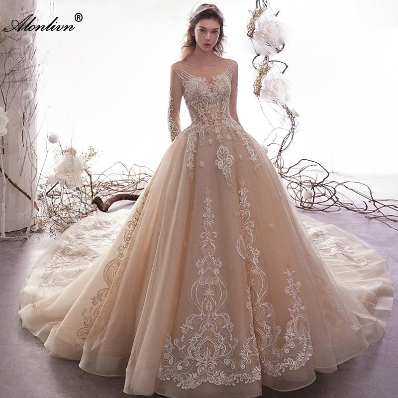 Vestido de novia de tres cuartos de cola de capilla de cuello redondo de perlas de encaje con apliques lustrosos de lonovn