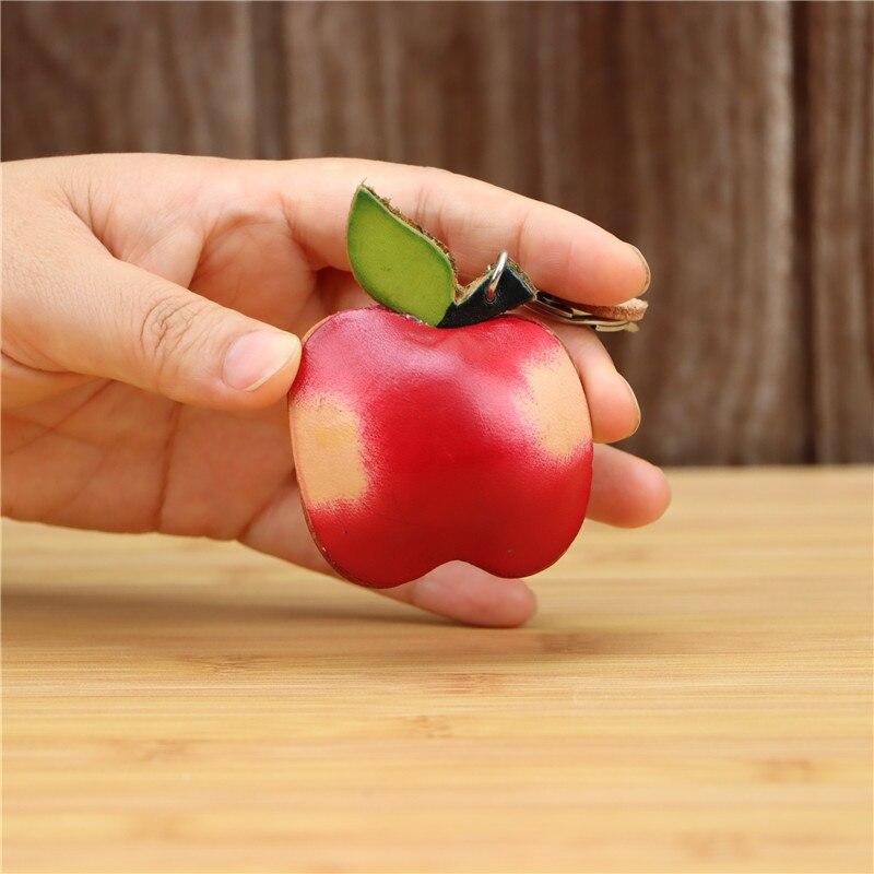 LLavero de cuero genuino hecho a mano creativo de manzana roja, colgante de bolso, mini bolso de cuero de vaca de fruta bonita, accesorios de regalo