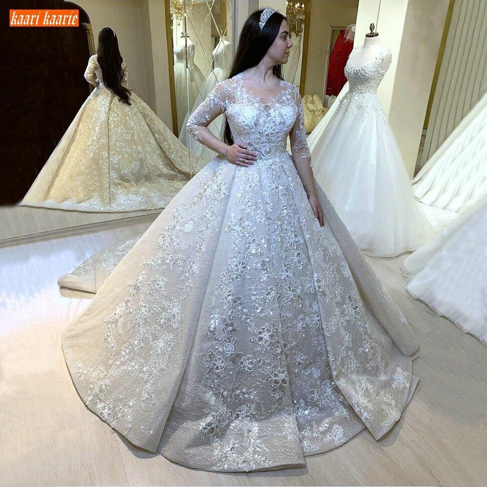 فساتين زفاف دانتيل عربية مزينة بأكمام طويلة باللون العاجي برقبة دائرية موديل 2020 فستان زفاف أبيض للأميرات في دبي